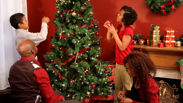 Black Family decorating their Christmas Tree