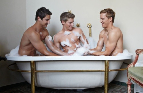 3 Gay Males naked in a bathtub. There is lots of suds