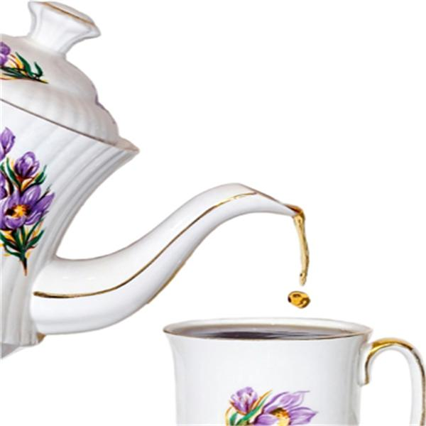 A teapot pouring tea